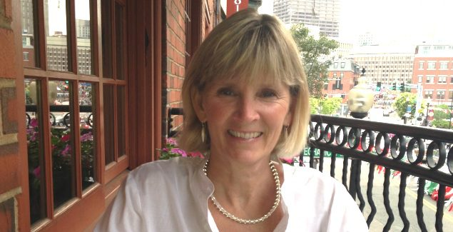 Image of Deedee sitting at an outdoor cafe in Boston