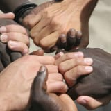 Black and white hands joined together