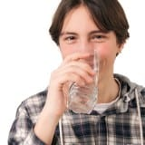 Teenage boy drinking water