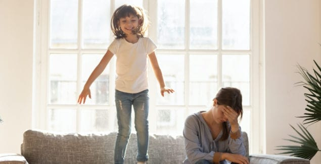 Anger - Knowing what sets you off - Girl jumping on a couch while a frustrated mom sits next to her