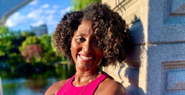 Khadijah Booth Watkins outdoors smiling
