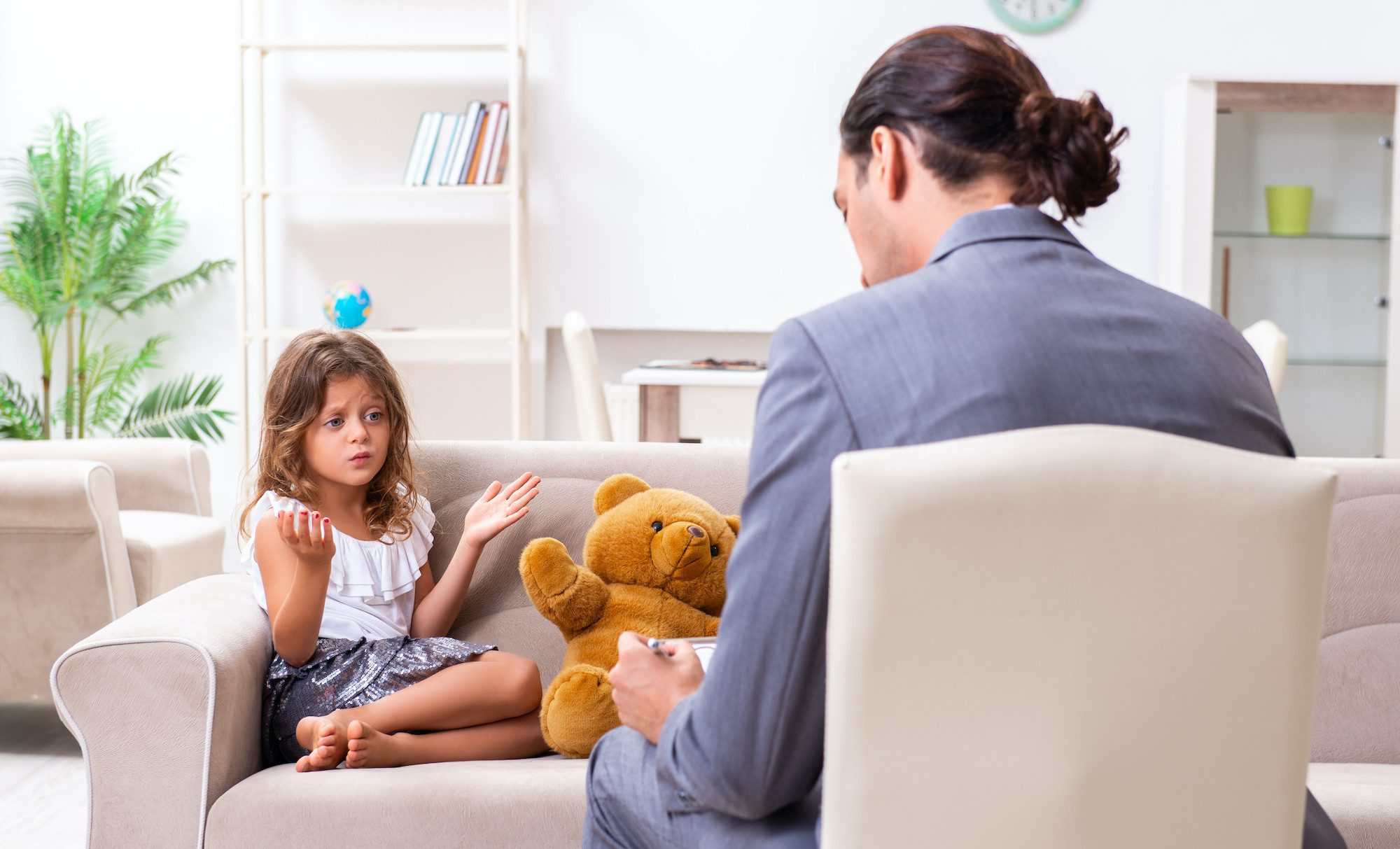 Therapist talking to girl on a couch