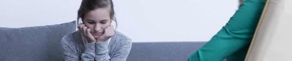 Sad teenage girl talking to a therapist