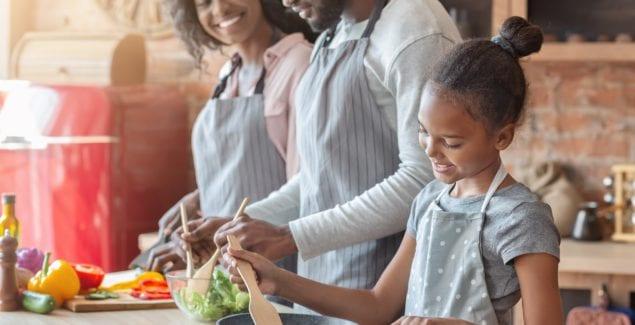 Vegan family preparing dinner together