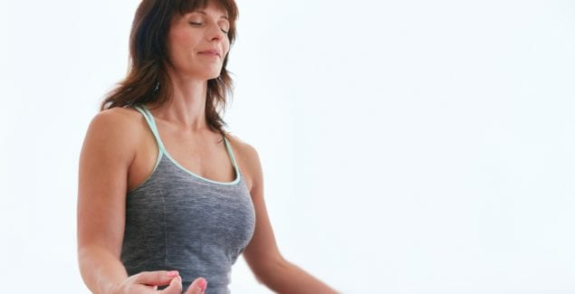woman practicing yoga: self-care