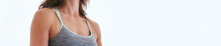 woman practicing yoga: self-care
