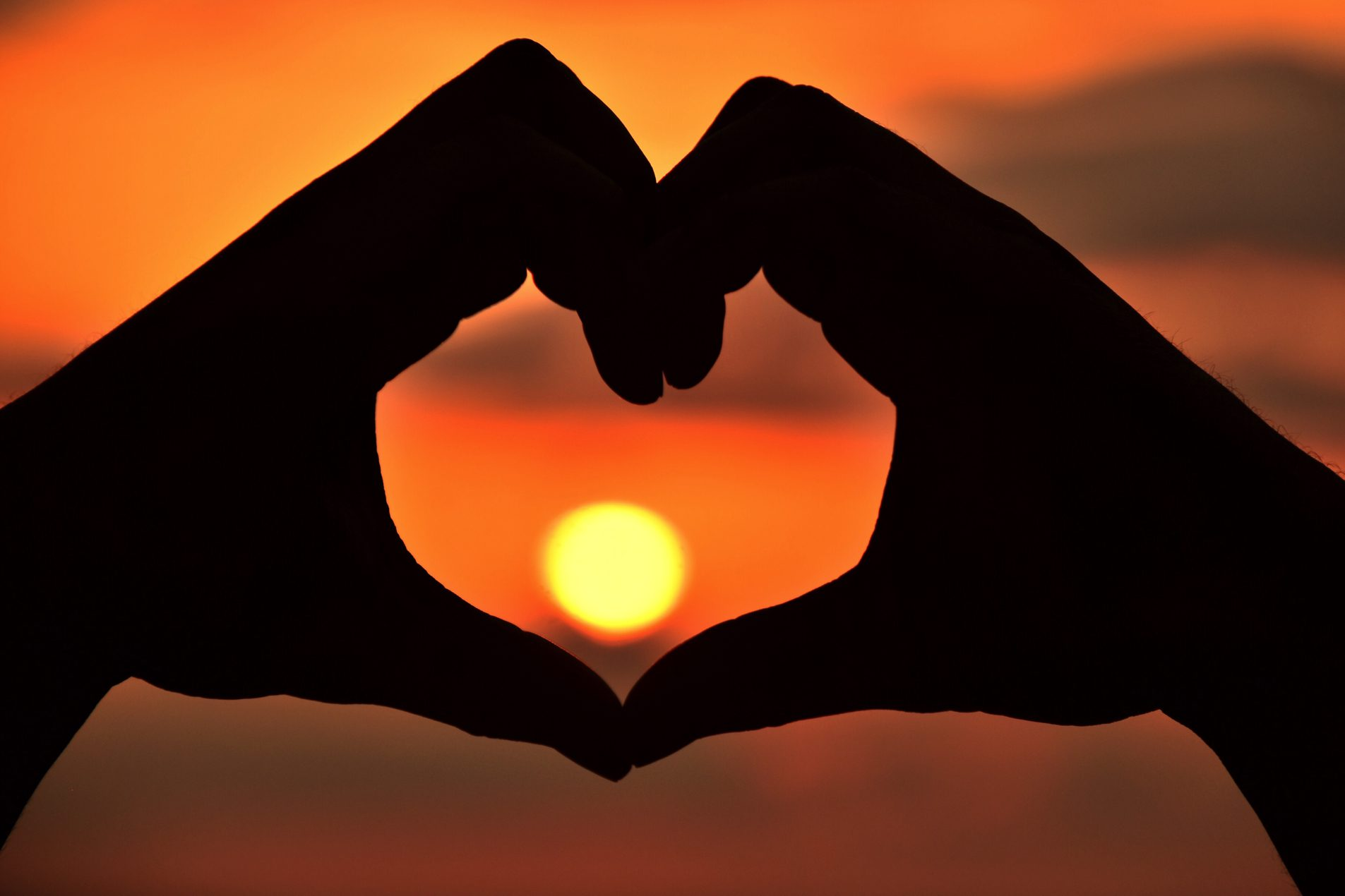 Clay Center Advisory Council - silhouette of hands making heart in front of sunset