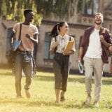 A multi-cultural group of students walking together on campus