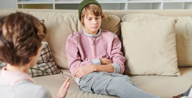 Irritated teenage boy at therapy session