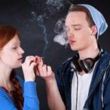 Horizontal view of a teenagers smoking marijuana joint
