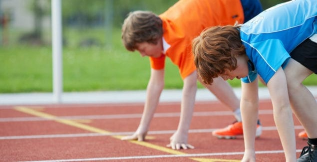 Two boys at the start line of a race