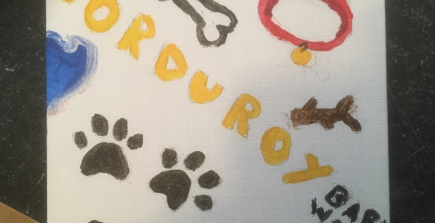 watercolor drawing with Corduroy's name surrounded by pictures of paws, a bone, his colloar, and a tennis ball.