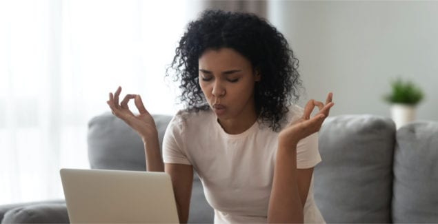 Teacher self-care - African woman sit on couch near laptop take break reduce stress do yoga meditation exercise to calm down