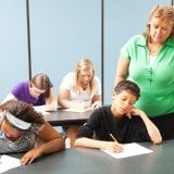 Teacher supervising students who are taking a standardized achievement test.