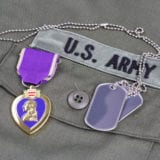 Military tags and Purple Heart award on US ARMY olive green uniform